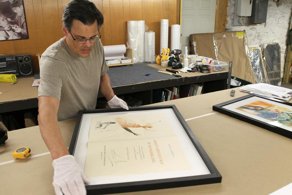 Nick Johnson prepared a page from a rare book for framing.