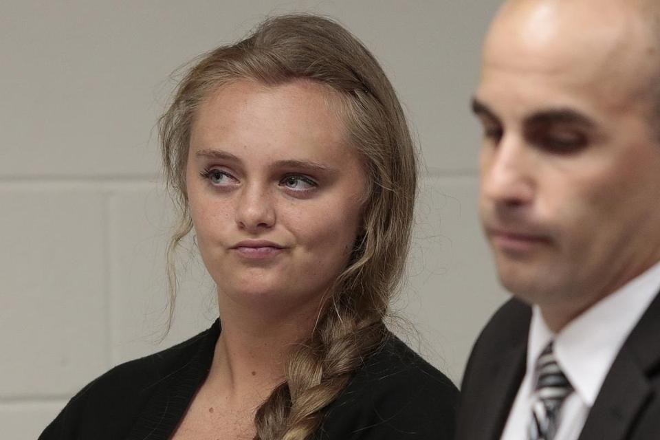 Michelle Carter listens to defense attorney Joseph P. Cataldo argues for the involuntary manslaughter charge against her to be dismissed, citing five separate arguments at Juvenile Court in New Bedford, Mass., Monday, Aug. 24, 2015. Michelle Carter, 18, of Plainville, MA is charged with involuntary manslaughter for allegedly pressuring Conrad Roy III, 18, of Fairhaven, Mass. to commit suicide on July 13, 2014. (Peter Pereira/The New Bedford Standard Times via AP)