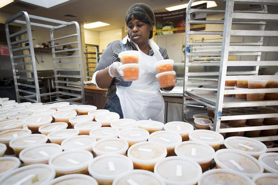 Volunteer Faviola Jean helped prepare meals for packaging at Community Servings on Thursday.