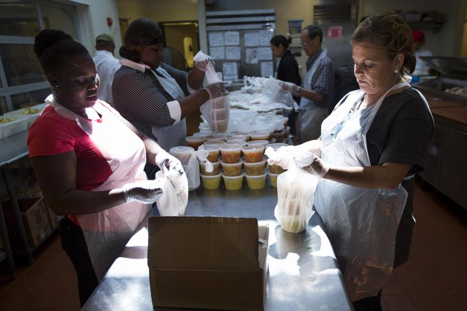 Meals were prepared for packaging by volunteers at Community Servings on Thursday, an agency that delivers meals to the sick who need help in Boston.