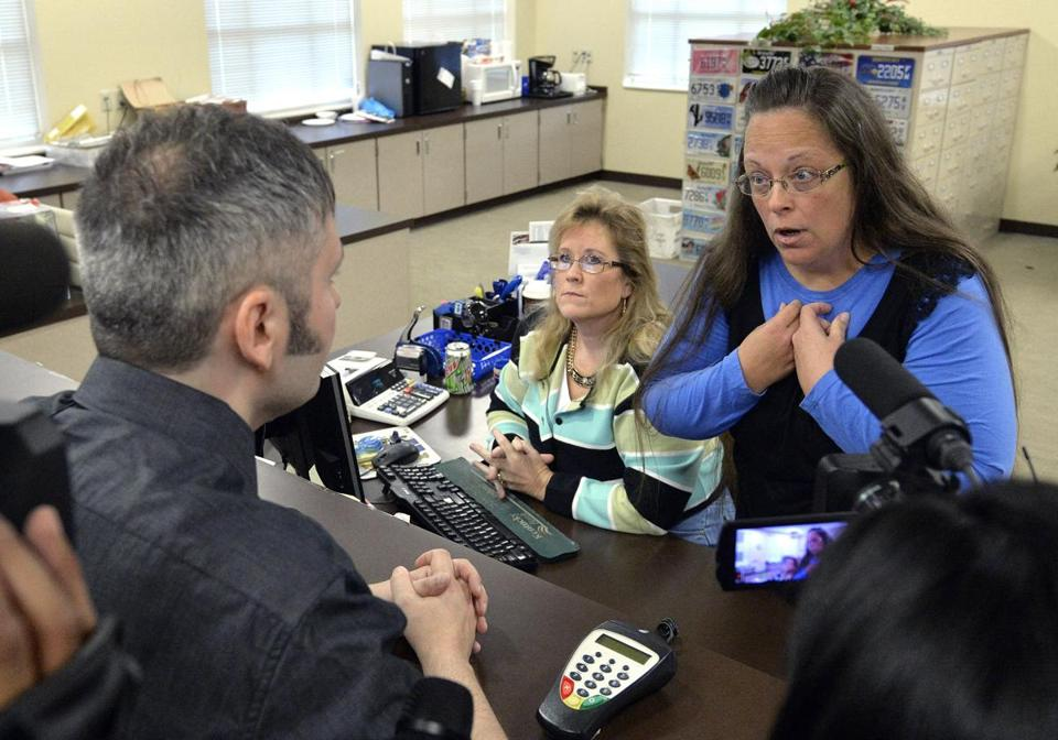 Kim Davis (right), the Rowan County, Ky., clerk of court, spoke with David Moore on Tuesday after her office continued to refuse to issue marriage licenses.