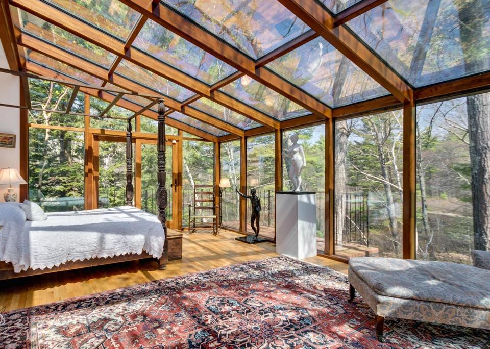 sherborn home features walls and ceilings of glass