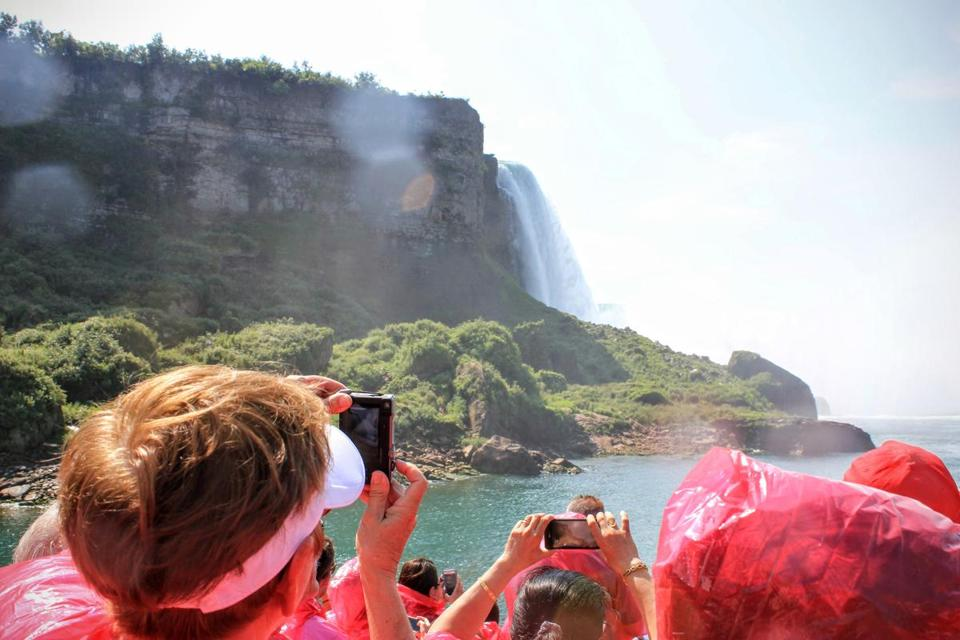 Visitors stay dry under ponchos on the cruise's Niagara Falls excursion.