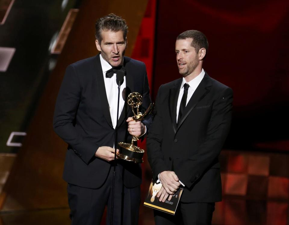 "David Benioff (L) and D.B. Weiss accept the award for Outstanding Writing For A Drama Series for HBO's ""Game of Thrones"" at the 67th Primetime Emmy Awards in Los Angeles, California September 20, 2015. REUTERS/Lucy Nicholson"