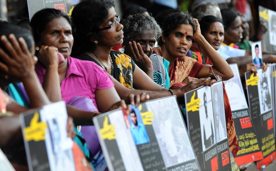 During a demonstration in Sri Lanka, relatives of Tamil activists held placards demanding the release of their loved ones who have been held in detention without trial for long periods of time.