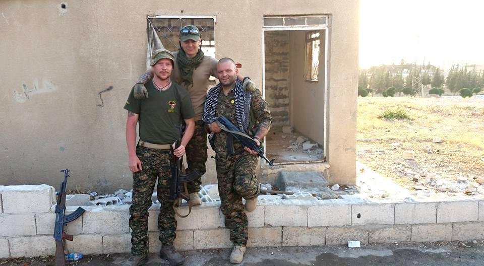 Joshua Washburn (right), a 36- year-old native of Springfield, went to Syria on his own earlier this year to fight with a militia against the Islamic State.