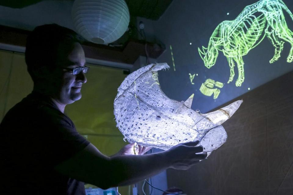 "Artist David Nunezin tested lighting on his installation ""Requiem for Rhinoceros"" at the MIT media lab in Cambridge on Sunday."