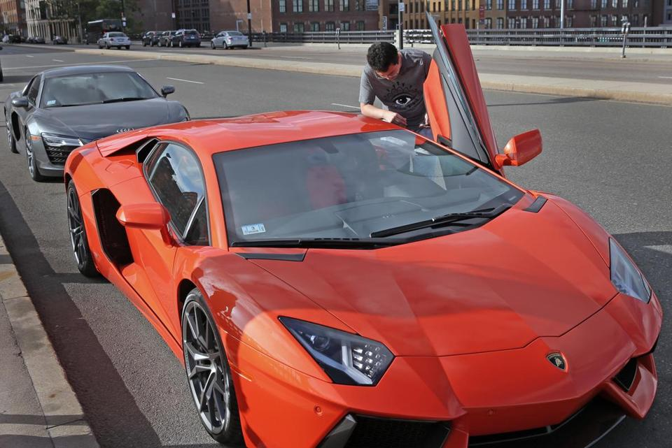 A student, who did not want to be identified, said he owns this orange Lambor-ghini and the Audi R8 Spyder behind it.