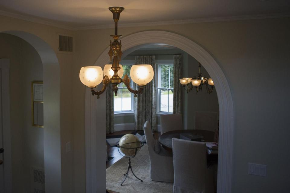 An 1870 Eastlake-style gas chandelier hangs in the home of Nicole Haughey in Newton.