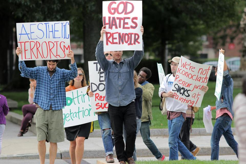 A group of playful protesters picketed outside the Museum of Fine Arts on Monday, expressing their dislike of painter Pierre-Auguste Renoir's work.