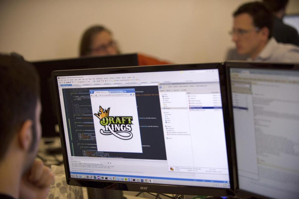 An employee at work for DraftKings in the company's offices in Boston on April 22, 2014.
