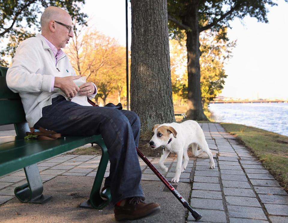 Jeff Schwartz paused to give Mandy a treat along the Esplanade.