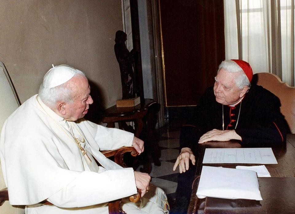 Pope John Paul II and Cardinal Bernard F. Law in a private audience at the Vatican. The pope made no public comment.