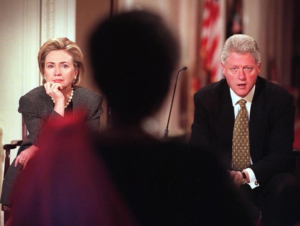 President Bill Clinton and Hillary Clinton listened in 1999 to a Rwandan woman's stories of surviving the 1994 genocide. Bill Clinton has said he is haunted by the massacres.