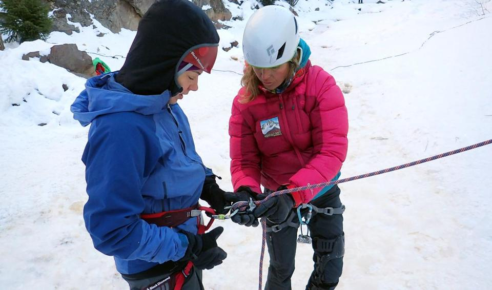 Sarah Heckles of Portland, Ore., gets instruction from climbing guide Karen Bockel.