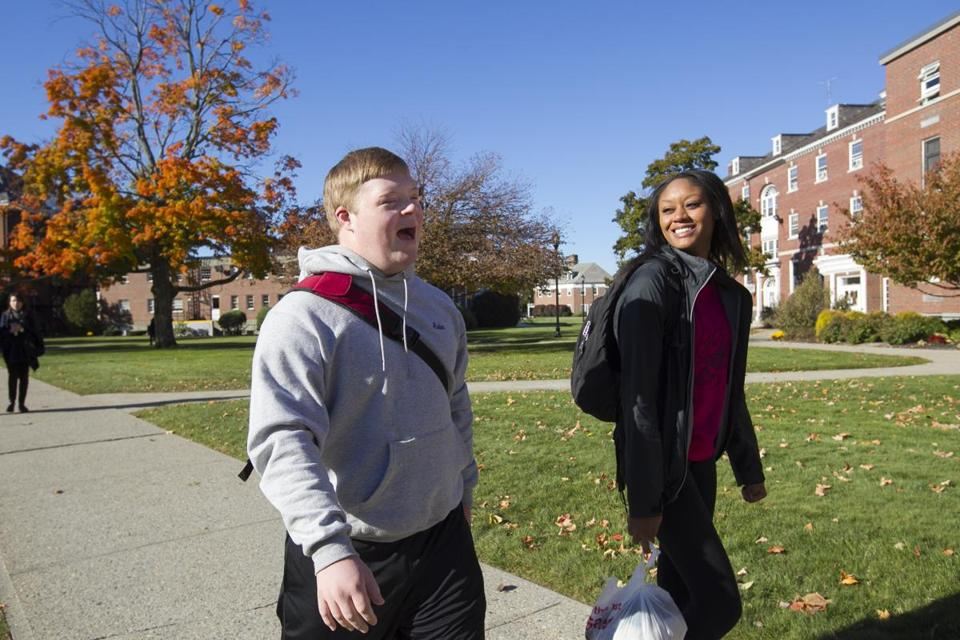 Aidan O'Donoghue, 19, of Northampton chatted with peer mentor Jasmine James, a junior at American International College, while walking across the AIC campus in Springfield.