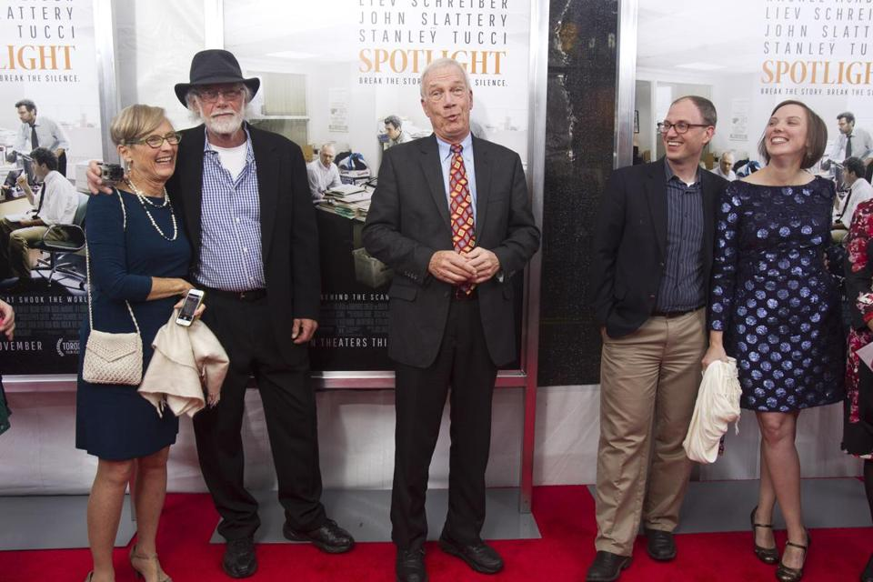 "10/28/2015 - Brookline, MA - Boston Globe reporter Walter Robinson, cq, center, walked the red carpet during the Boston premiere of Spotlight. Actors, producers, and newspaper reporters walked the red carpet in front of the Coolidge Corner Theatre in Brookline on Wednesday evening, October 26, 2015 for the Boston premiere of ""Spotlight,"" the film about The Boston Globe's investigation of the Catholic Church sexual abuse scandal. Topic: 26film. Photo by /Boston Globe"
