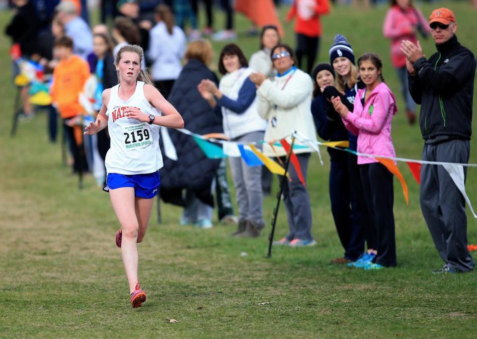 Wrentham Ma 11/07/2015 Grace Connolly (cq) of Natick High School leads the pack as she heads to the finish line during the Junior/Senior Division 1 race at the Mass State Coaches Cross-Country Meet. Staff/Photographer Jonathan Wiggs Topic: Reporter