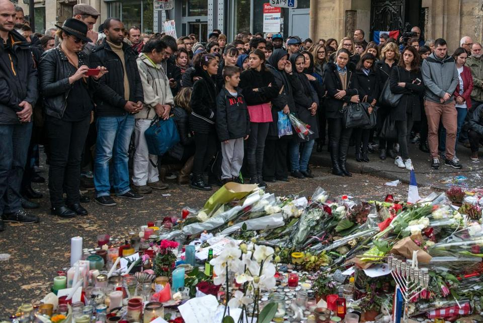 People observed a minute of silence near the Bataclan concert hall on Sunday to honor the victims of Friday's attacks in Paris. The Bataclan was one of the sites targeted by terrorists that night.