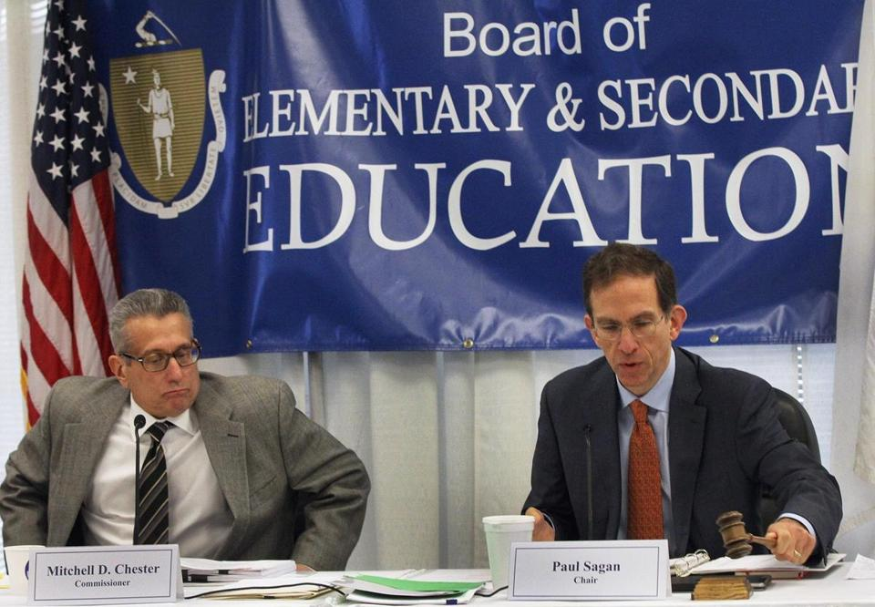 Commissioner Mitchell D. Chester & Chair Paul Sagan during a meeting of the Board of Elementary and Secondary Education in Malden last year.