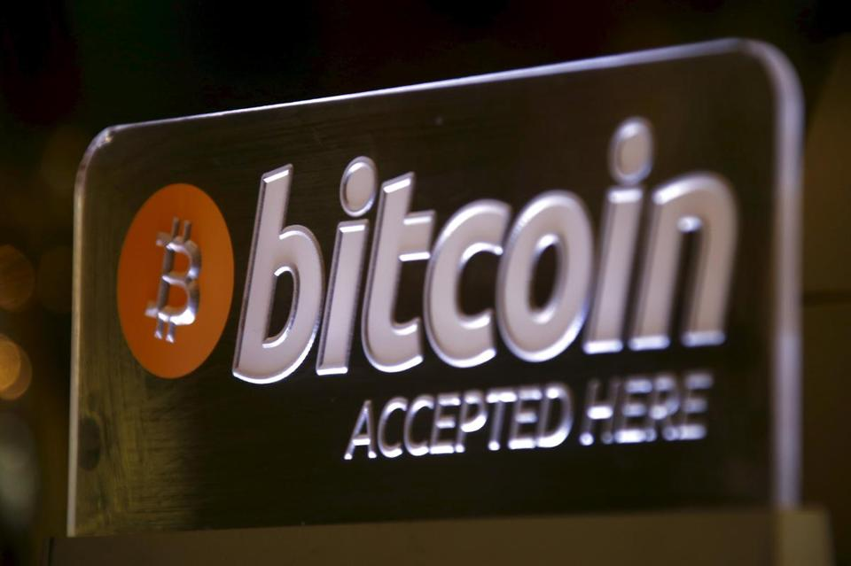 A Bitcoin sign can be seen on display at a bar in central Sydney, Australia, September 29, 2015. Australian businesses are turning their backs on bitcoin, as signs grow that the cryptocurrency's mainstream appeal is fading. Concerns about bitcoin's potential crime links mean many businesses have stopped accepting it, a trend accelerated by Australian banks' move last month to close the accounts of 13 of the country's 17 bitcoin exchanges. Picture taken September 29, 2015. REUTERS/David Gray