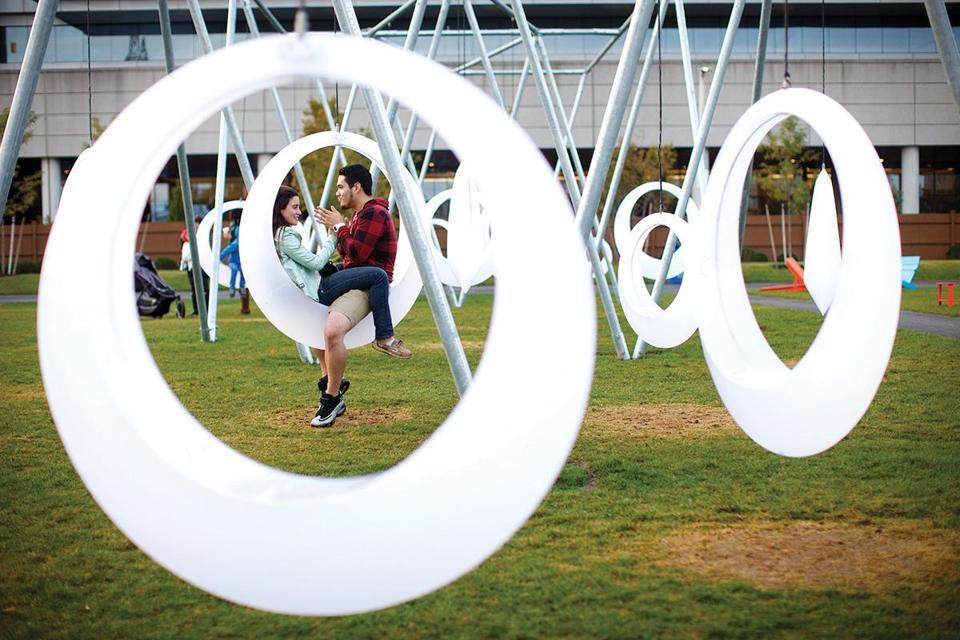 Cassondra Richards of Boston and Mario Rodriguez of Queens, N.Y., enjoyed the public art at the Lawn on D shortly after its opening in 2014.