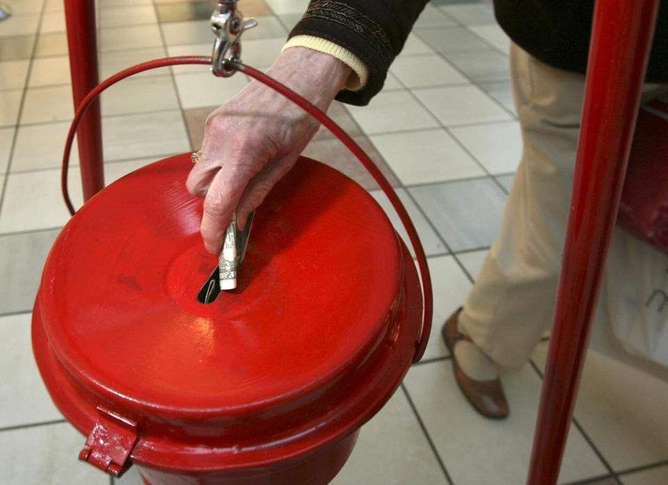A woman put money into the Salvation Army kettle at the South Shore Plaza.