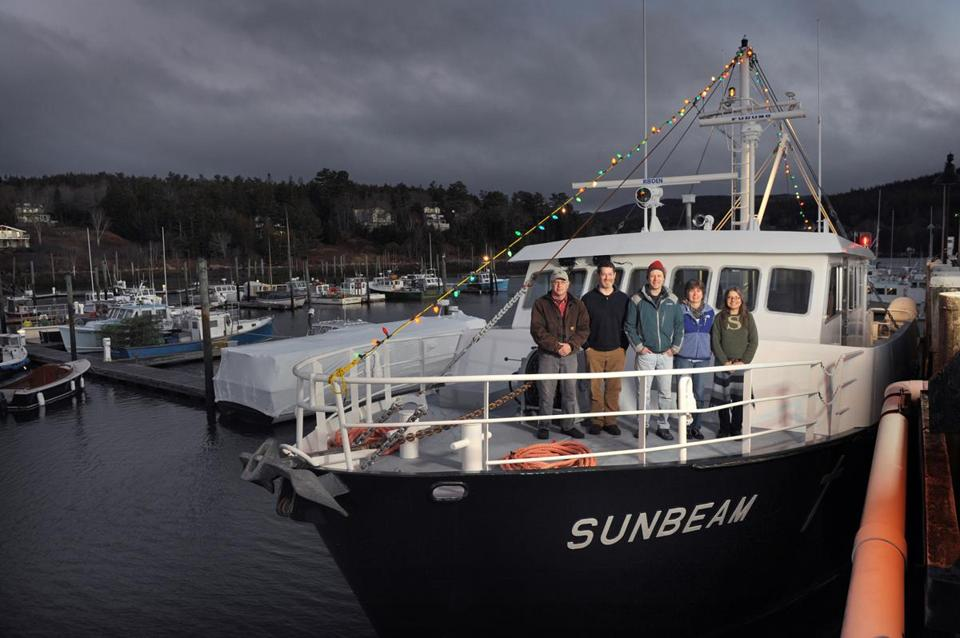 From left: engineer Storey King, island outreach director Douglas Cornman, captain Michael Johnson, nurse Sharon Daley, and steward Jillian aboard the Sunbeam.