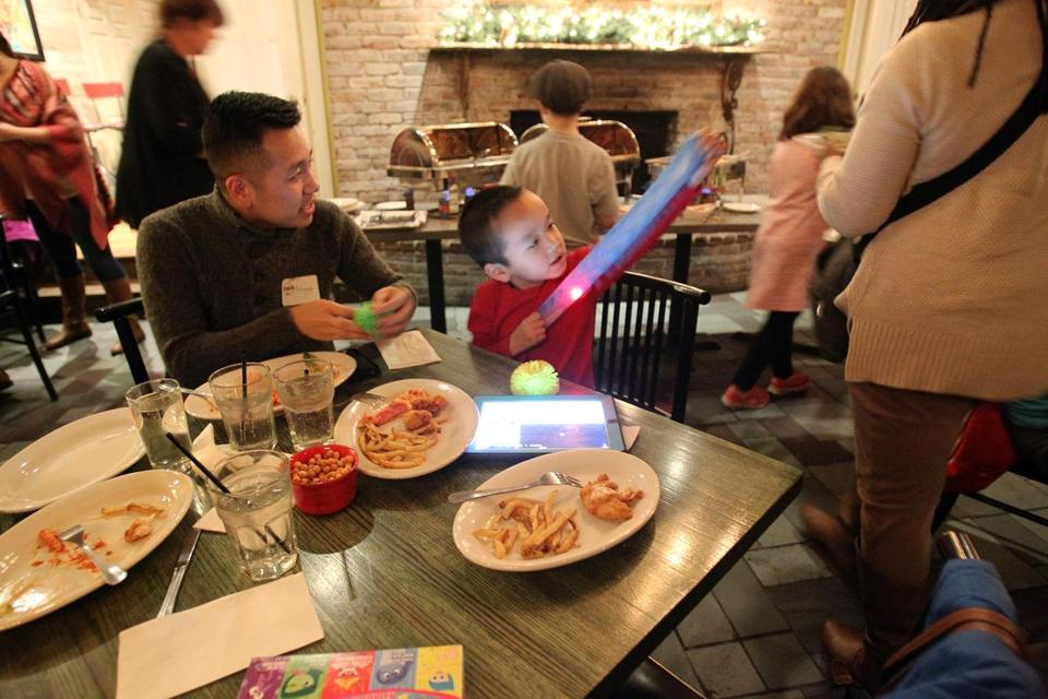 Landon Sorth played with a toy as he shared a meal with his uncle Armani Thao.