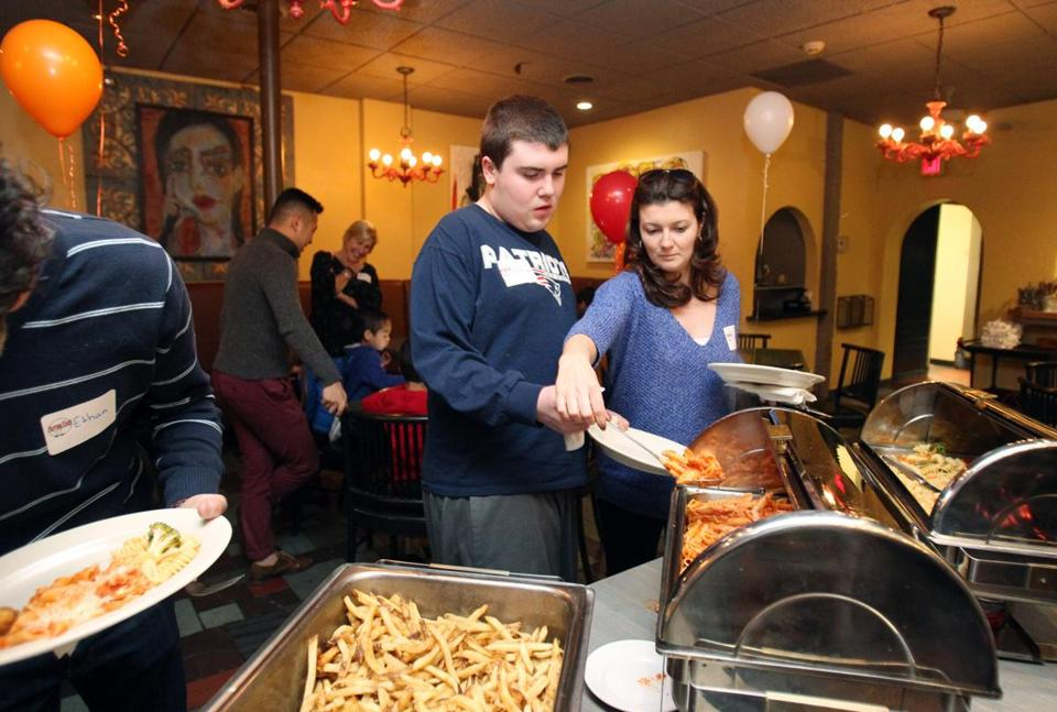 LeeAnn Mahoney helped Rory Callahan on the buffet line.