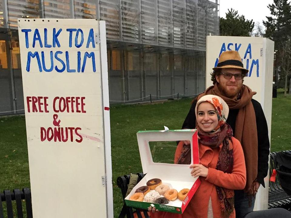 Mona Haydar and her husband, Sebastian Robins, stood outside of a library in Cambridge.