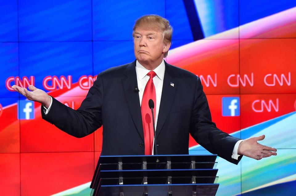 (FILES) This file photo taken on December 15, 2015 shows Republican presidential candidate and businessman Donald Trump gesturing during the Republican Presidential Debate, hosted by CNN, at The Venetian Las Vegas in Las Vegas, Nevada. Trump was voted as one the most influential figures of 2015 by AFP journalists. Just a few weeks out from the primaries, the conservative and provocative businessman seems unshakeable from the top of the Republican polls and could well find himself opposite Democrat Hillary Clinton in the 2016 US presidential elections. / AFP / ROBYN BECKROBYN BECK/AFP/Getty Images