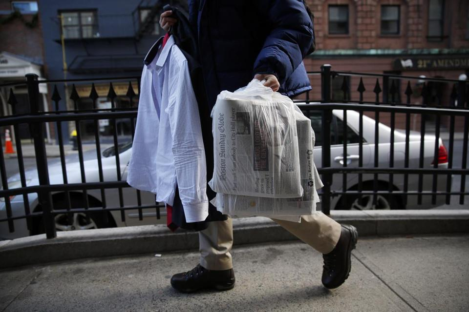 A Globe reporter carried a suit en route to an interview Sunday, after spending hours assisting with deliveries of the Sunday Boston Globe.