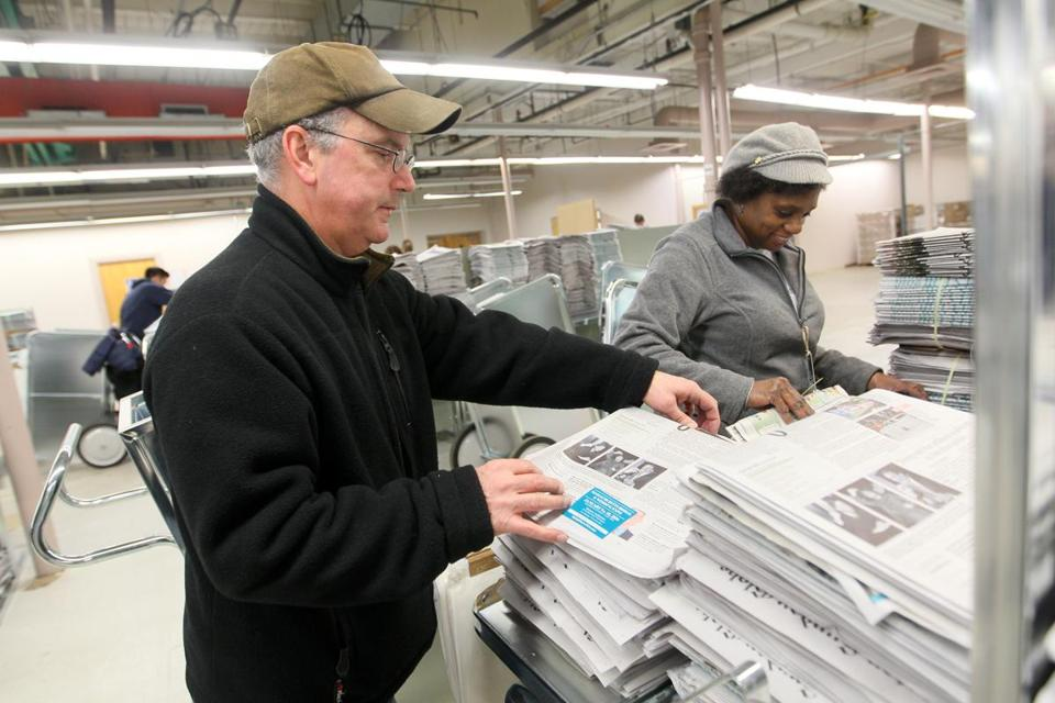 12/3/16, MA - -NEWTON ,MA - Globe employees Sean Murphy and Paula Bouknight assemble newspapers at the Newton distribution center before setting out to deliver The Boston Globe overnight. , (globe staff photo :Joanne Rathe reporter: topic: section: METRO)