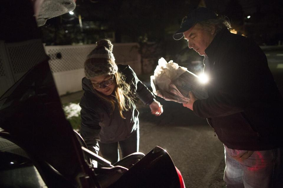 1/3/2016 - Cambridge, MA - Boston Globe photographers (at left is Jessica Rinaldi, cq; at right is Bill Greene) worked in the pre-dawn hours to deliver the Sunday Boston Globe on Sunday morning, January 3, 2016. Photo by Dina Rudick/Globe Staff