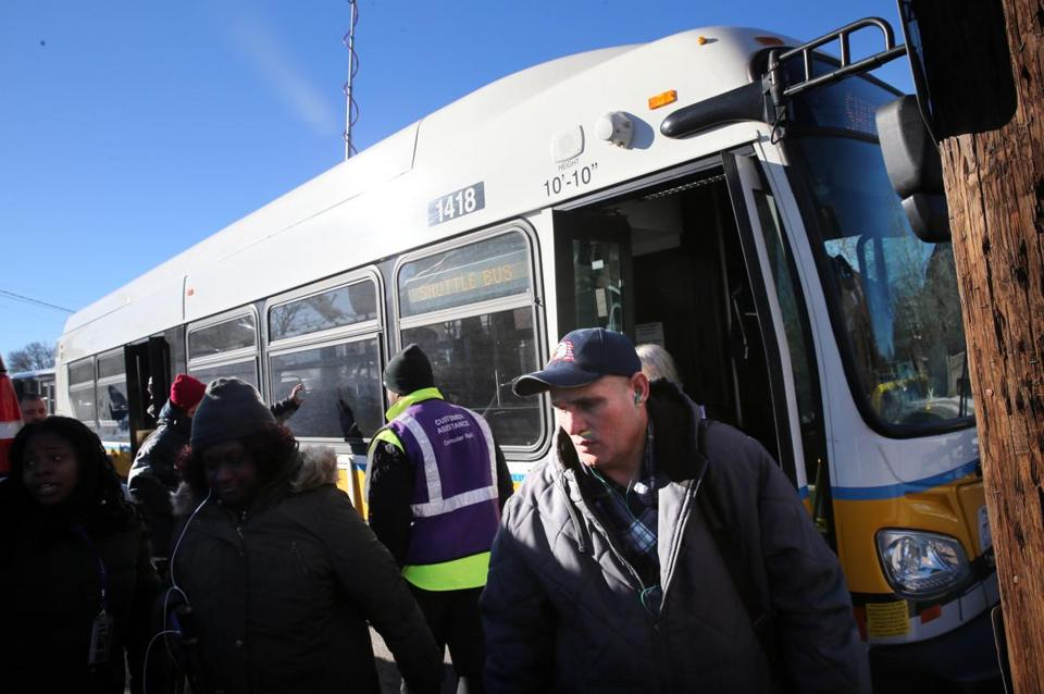 A shuttle bus arrived at the Andover commuter rail station on Tuesday. Passengers were bussed for part of Tuesday morning's commute between Lawrence and Andover stations. Track issues on the Haverhill line trickled down and affected many commuter rail trips on trains heading to and from North Station.