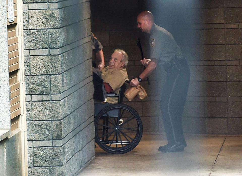 Robert Gentile was brought into the federal courthouse in a wheelchair for a continuation of a hearing in Hartford, Conn.