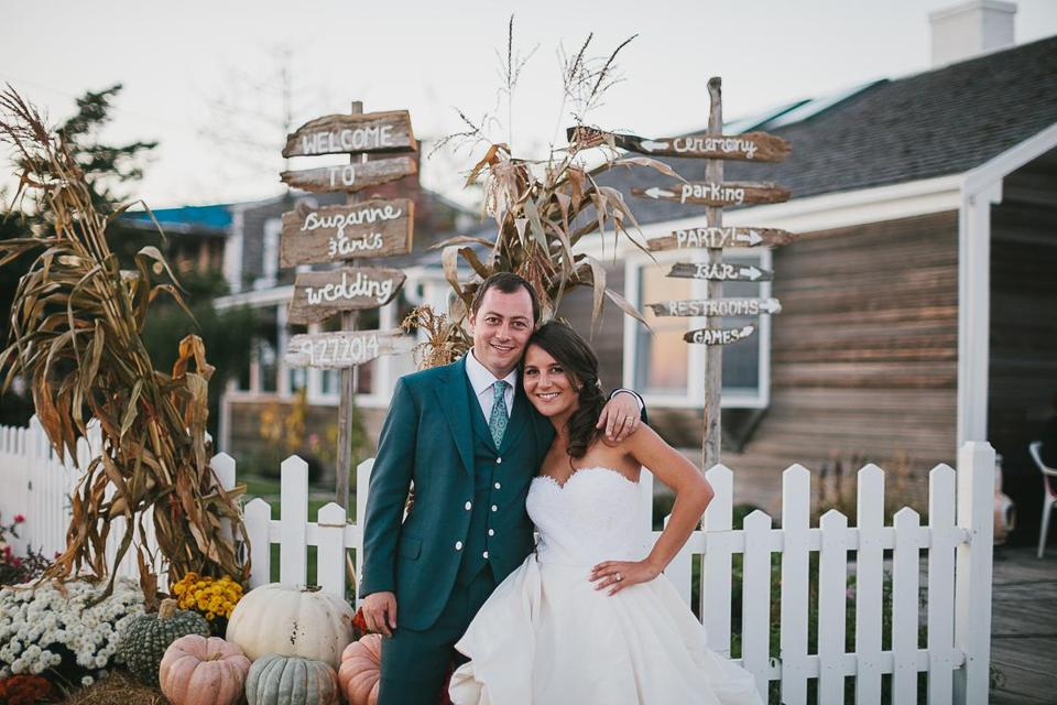 Hand-painted driftwood signs made by one of the groom's co-workers add whimsy to Ari and Suzanne Gray's wedding in Wellfleet.