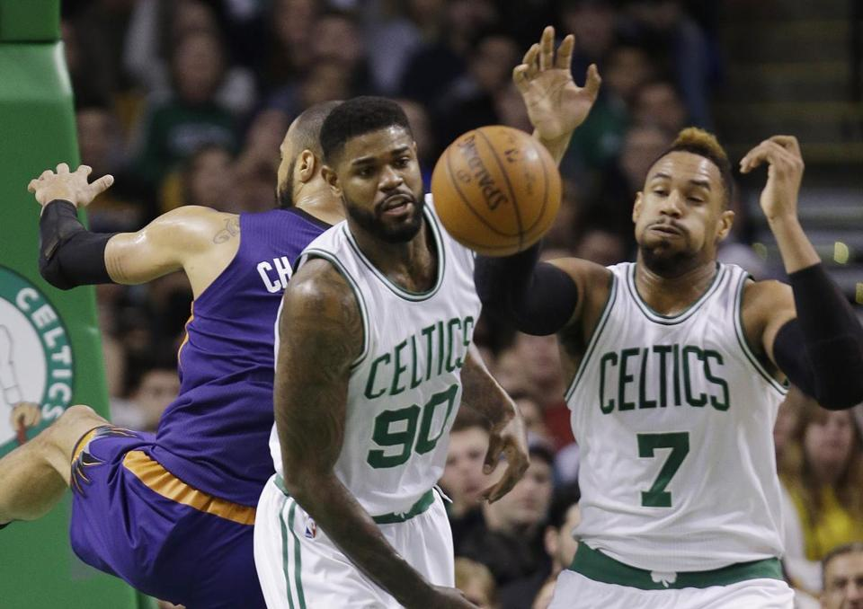 Boston Celtics center Jared Sullinger (7) and forward Amir Johnson (90) react to the ball under the defensive boards during the first quarter of an NBA basketball game against the Phoenix Suns, Friday, Jan. 15, 2016, in Boston. (AP Photo/Stephan Savoia)
