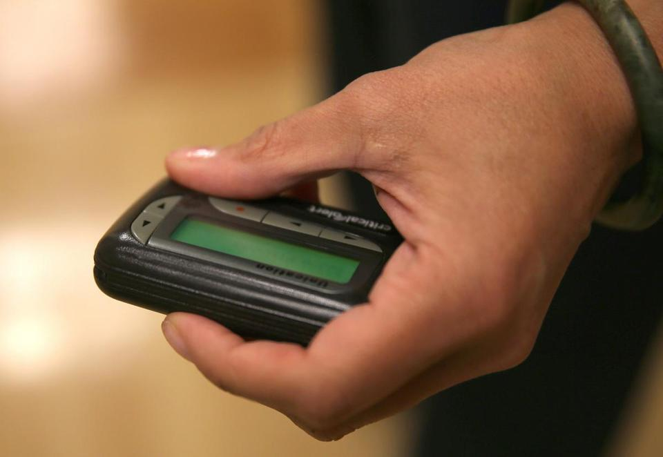Yvette Hall-Swain, a nurse manager in emergency services at South Shore Hospital in Weymouth, held a pager. About 85 percent of hospitals still rely on the devices, analysts said.