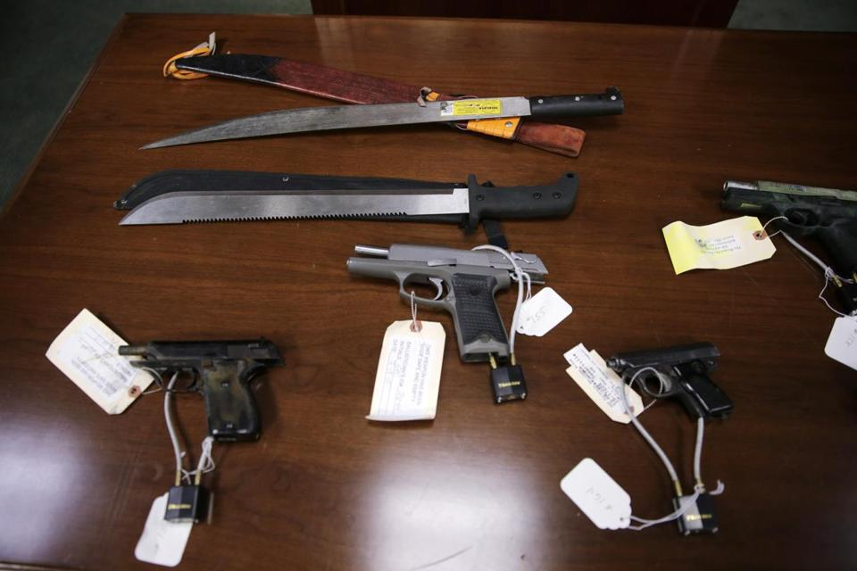 Weapons on display at the U.S. Attorney's office following the arrests of alleged MS-13 gang members in Boston late last month.