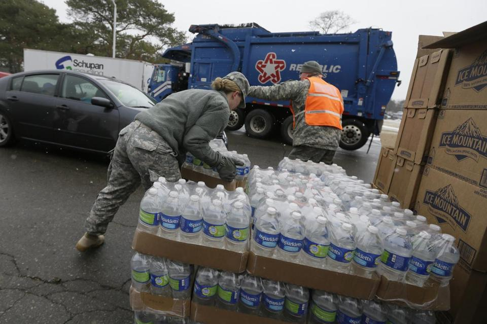 Members of the Michigan National Guard loaded bottled water at a fire station in Flint, Mich., on Thursday.