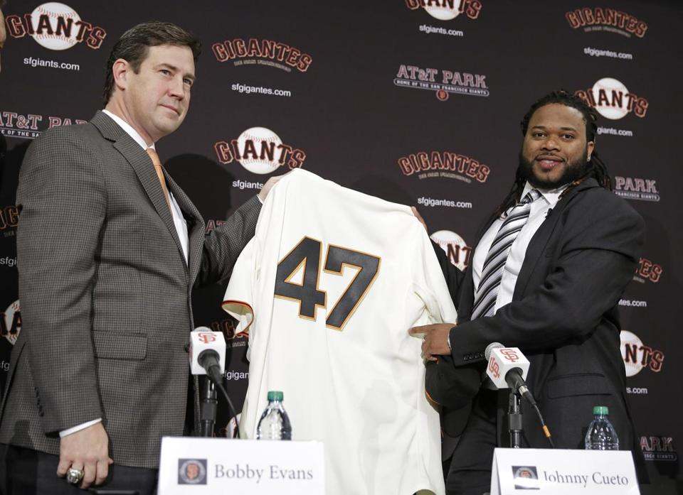 Bobby Evans (left) signed Johnny Cueto to a $130 million, six-year contract.