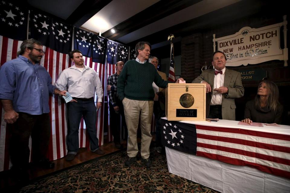 Resident Jeff Stevens (center) cast the first vote shortly after midnight in Dixville Notch, N.H.