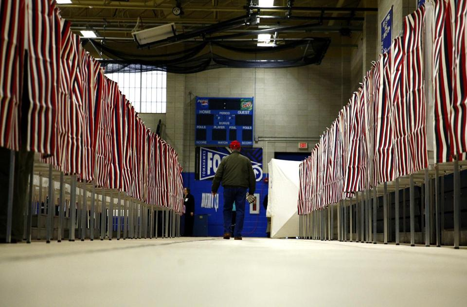Voting booths were set up at the polling station at Merrimack High School in Merrimack, N.H., Tuesday.