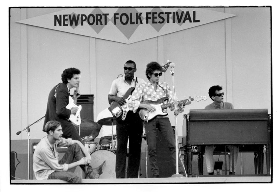 Bob Dylan (center) at the 1965 Newport Folk Festival, accompanied bykeyboardist Al Kooper, who will join in a Dylan tribute concert at the Berklee Performance Center on Feb. 28.