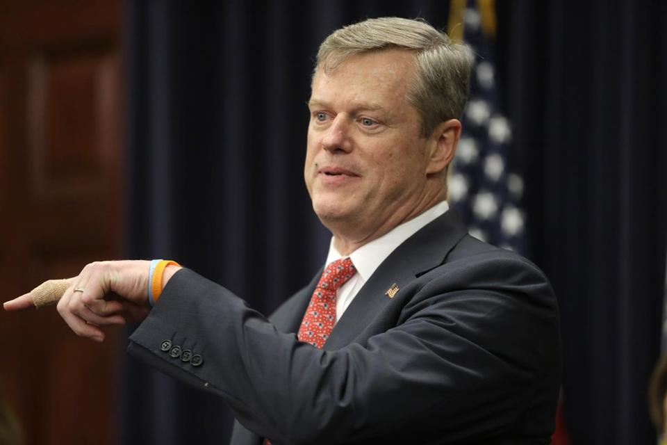 Massachusetts Gov. Charlie Baker faces reporters Monday, Jan. 25, 2016, at the Statehouse, in Boston. Baker signed a bill into law Monday officially ending the state's longstanding practice of sending women with alcohol or substance abuse problems but who have committed no crimes to the state prison for women in Framingham. (AP Photo/Steven Senne)