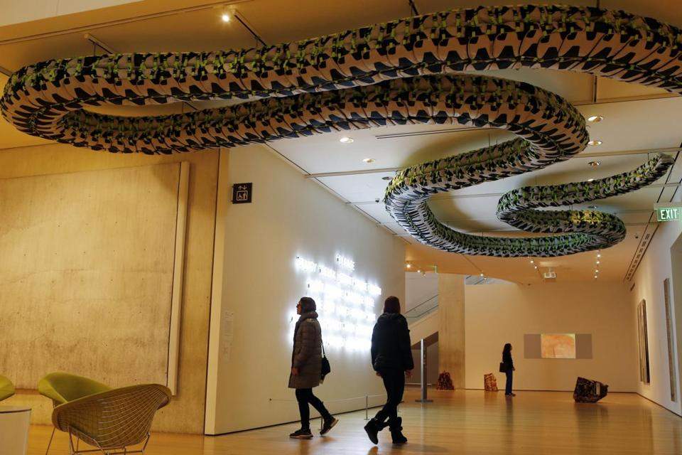 People walk underneath a piece by Ai Weiwei called, 'Snake Ceiling' at the Museum of Fine Arts in Boston last month.