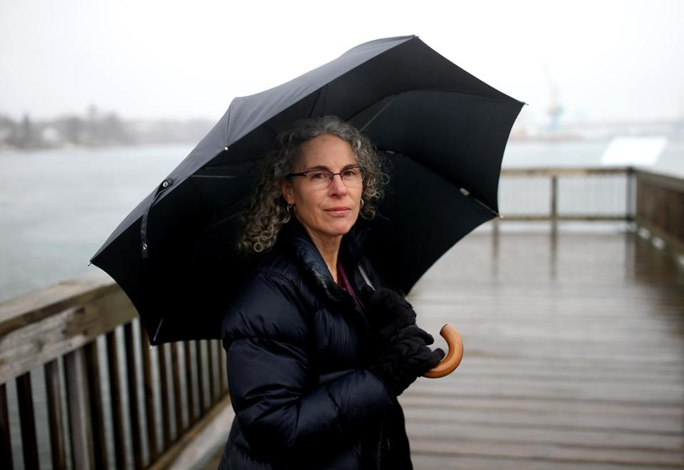 Katherine Towler stands on a pier in Prescott Park, overlooking the Piscataqua River, in Portsmouth, N.H. A plaque at pier's end displays a poem by her friend, the late Robert Dunn.