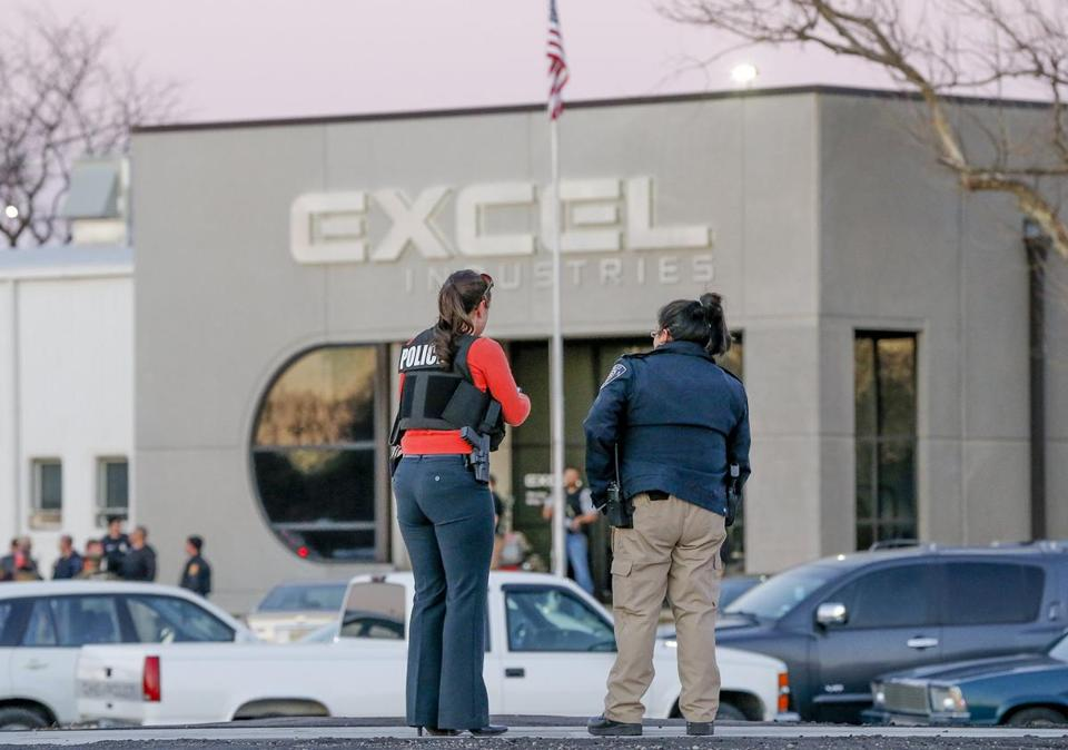 Police guarded the front door of Excel Industries in Hesston, Kan., on Thursday.